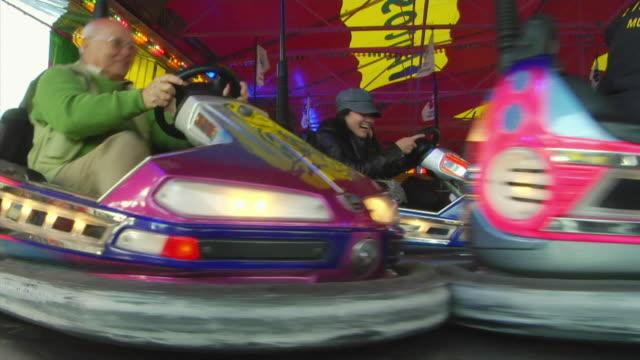 ws bumper cars at oktoberfest fair, munich, germany - bumper car stock videos & royalty-free footage