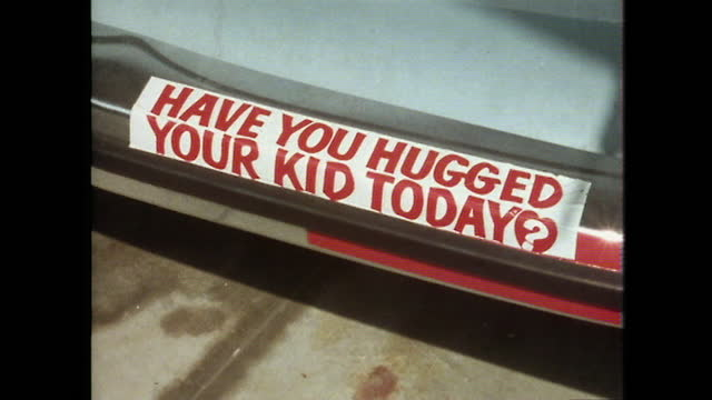 """bumper sticker reads """"have you hugged your kid today?""""; 1979 - question mark stock videos & royalty-free footage"""