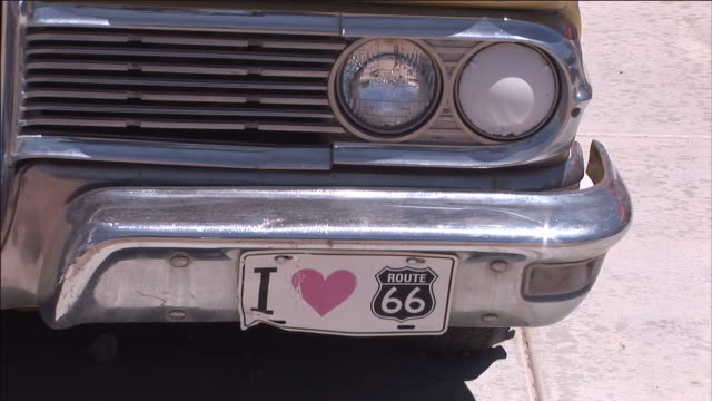 a bumper sticker reads i love route 66. - sticker stock videos and b-roll footage