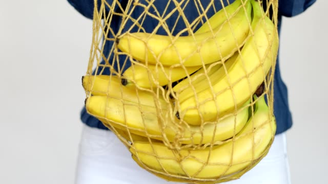 bunch of banana falling into the shopping net - slip banana stock videos & royalty-free footage
