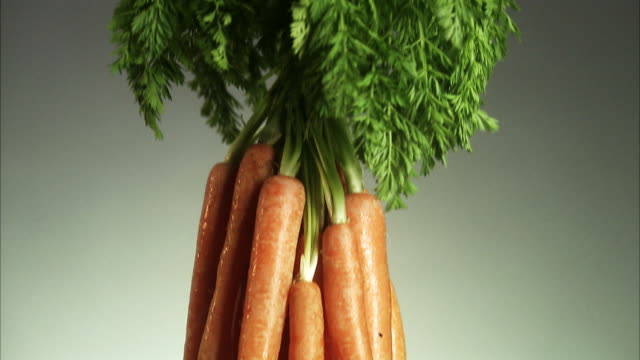 a bunch of carrots. - möhre stock-videos und b-roll-filmmaterial