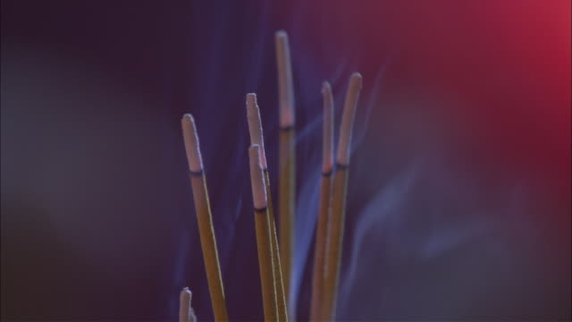 cu bunch of incense burning at buddhist temple, melbourne, victoria, australia - incense stock videos & royalty-free footage