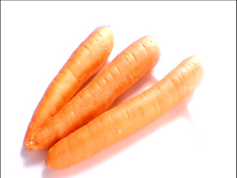 Bunch of raw carrots increases one by one