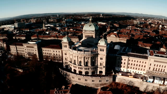 bundeshaus or federal palace in bern by aerial view - federal building stock videos & royalty-free footage