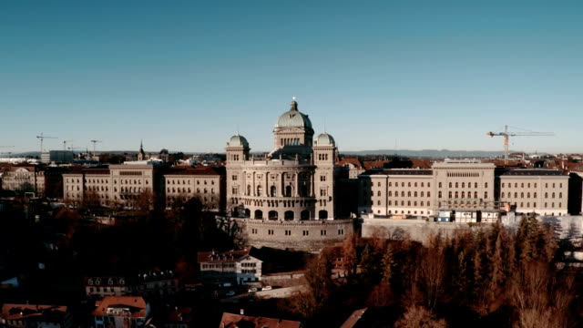 bundeshaus or federal palace in bern by aerial view - parliament building stock videos & royalty-free footage