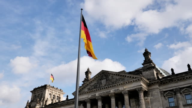 bundestag - german parliament in berlin with waving german flag - government building stock videos & royalty-free footage