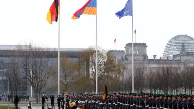 bundeswehr music corps (part of the honorary formation is preparing to play at the state ceremony at the chancellery, in the background the reichstag... - german military stock videos & royalty-free footage