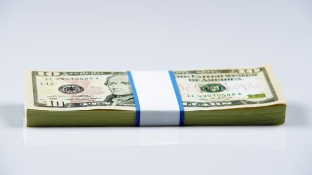bundle of american money. - banconota da 10 dollari statunitensi video stock e b–roll