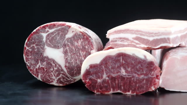 bundle pack 9 clip of different types of fresh raw pork meat and beef for slicing on a dark table in the kitchen. - frozen stock videos & royalty-free footage