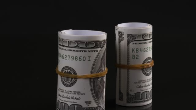 bundled dollar on black background. - bundle stock videos & royalty-free footage