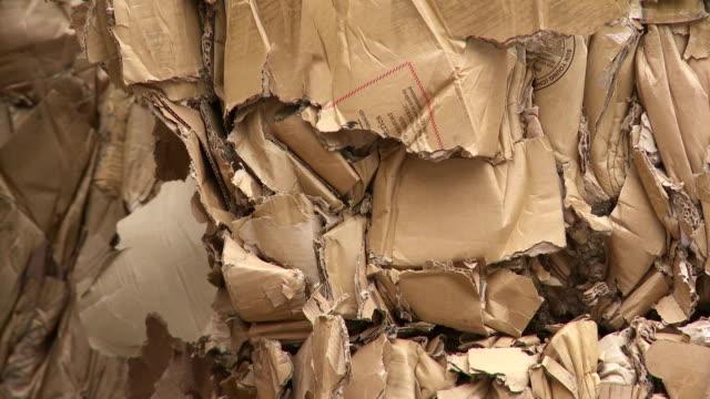 bundles of cardboard waste tilt up - carton stock videos & royalty-free footage