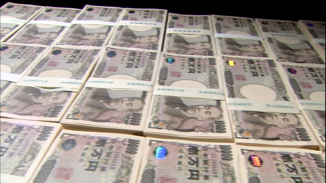 bundles of three hundred million yen bills lie side by side in tokyo-to shibuyaku, japan. - side by side stock videos & royalty-free footage