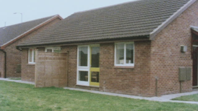 1983 montage bungalows in south ribble community with community center under construction / england, united kingdom - bungalow stock videos and b-roll footage