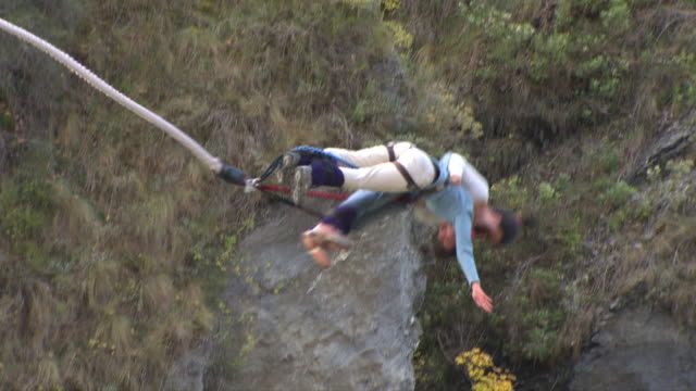 bungee jumping duo - queenstown stock videos & royalty-free footage