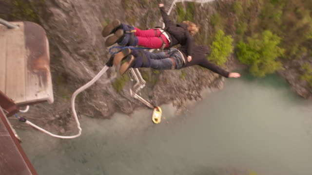 bungy pioneer aj hackett and his daughter margaux hackett in tandem bungy jump at kawerau bridge near queenstown - queenstown stock videos & royalty-free footage