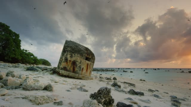 a bunker from world war ii remains on a beach at wake island, part of pacific remote islands marine national monument. - bomb shelter stock videos & royalty-free footage