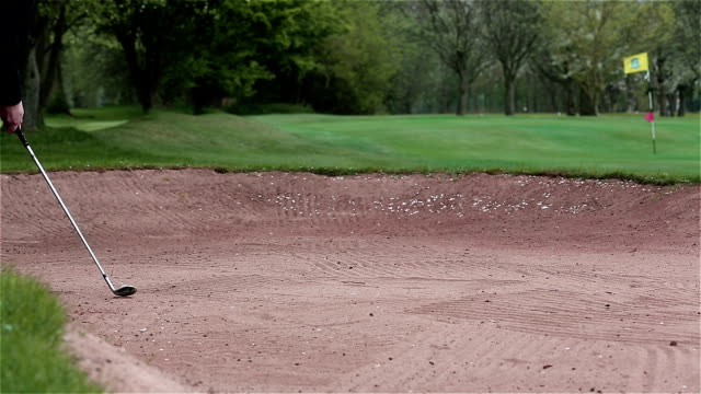 bunker shot on a windy day - sand pit stock videos and b-roll footage