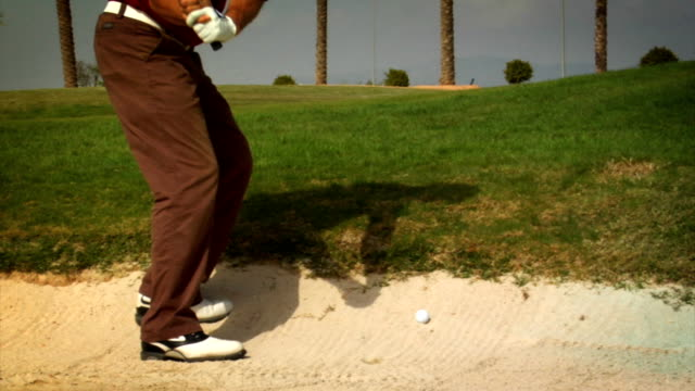 bunker shot - golf swing motion stock videos & royalty-free footage