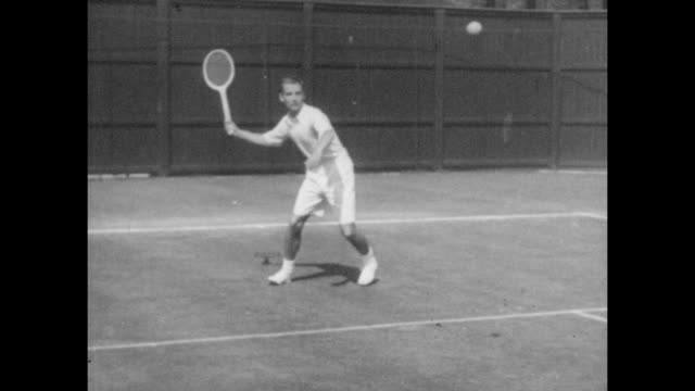 bunny austin practicing at the all england lawn tennis and croquet club in wimbledon, south east london, circa 1935 - forehand stock videos & royalty-free footage