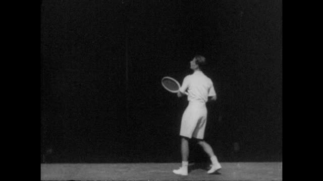hw bunny austin practicing at the all england lawn tennis and croquet club in wimbledon south east london circa 1935 - tennis racket stock videos & royalty-free footage