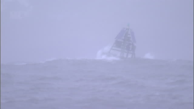 a buoy bobs in a turbulent sea. - sea stock videos & royalty-free footage