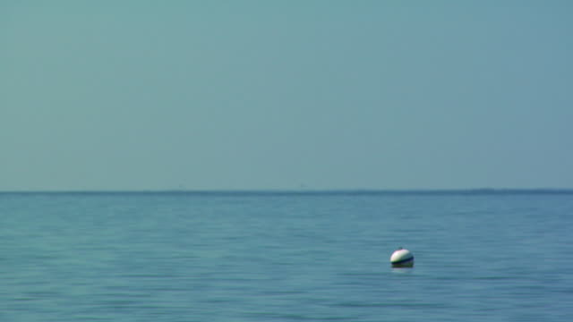 ms, buoy floating in ocean, north truro, massachusetts, usa - buoy stock videos & royalty-free footage