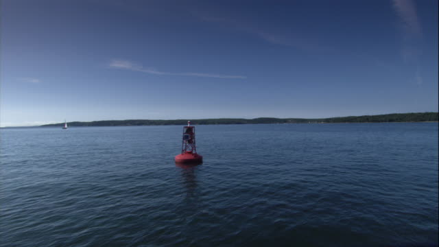 a buoy floats on a calm sea. - buoy stock videos & royalty-free footage