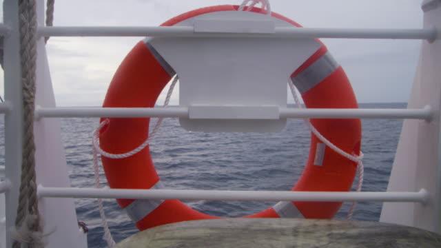 vídeos de stock, filmes e b-roll de a buoy on a boat shot - boia equipamento marítimo de segurança