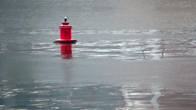 Buoy on calm river