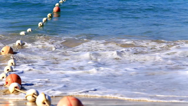 buoy on sea with wave make safe area for tourist swimming - buoy stock videos & royalty-free footage
