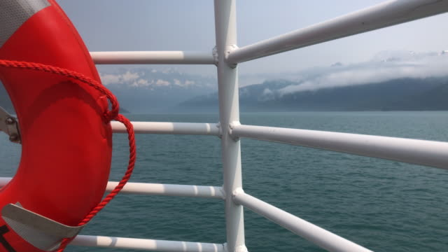 buoy on tour boat sailing in the sea, alaska - buoy stock videos & royalty-free footage