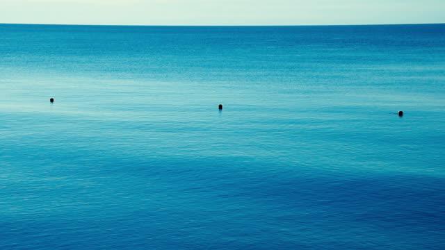 buoys on the blue sea surface