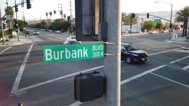 burbank boulevard city street sign looking down at intersection - burbank stock videos & royalty-free footage