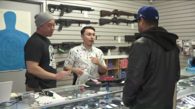 ktla burbank ca us men choosing and buying weapons at gun store during covid 19 outbreak in burbank on friday march 20 2020 - armeria negozio video stock e b–roll