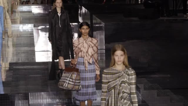 burberry holds its london fashion week show at the olympia exhibition centre. two pianists on grand pianos serenaded the models as they strutted... - runway stock videos & royalty-free footage