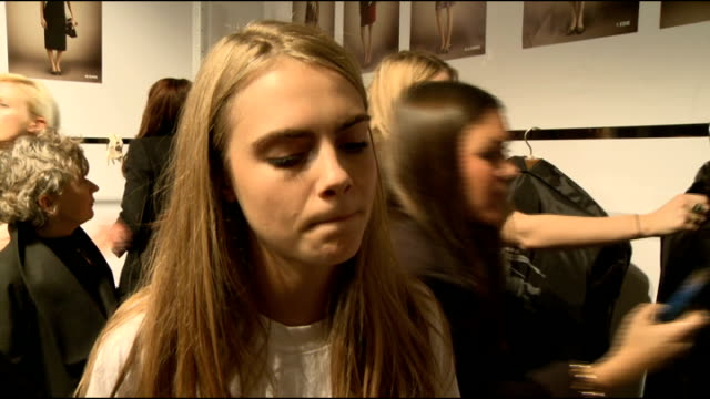 Burberry Show interviews Cara Delevingne interview SOT Delevingne posing with unidentified man / Delevingne chatting to others Jourdan Dunn alongside...