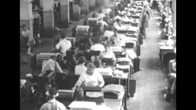 bureau of engraving and printing / tilt down long row of workers printing money / man engraves new plate / vs man works machine that roll over new... - 1920 1929 stock videos & royalty-free footage