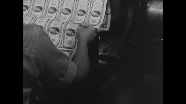stockvideo's en b-roll-footage met cu 'bureau of engraving printing' int ws americans working w/ money sheets printing machines cu woman feeding sheet into machine vs cu money sheet vs... - 1937