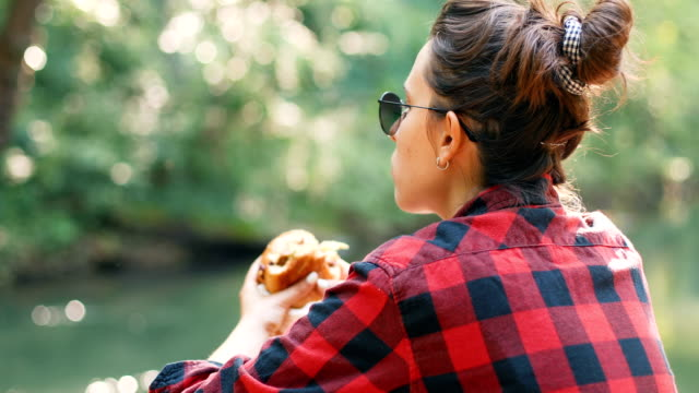 burger by the river - snack stock videos & royalty-free footage