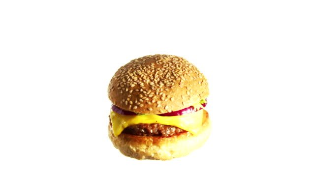 burger cheeseburger spinning and rotating isolated on white background food suspended in the air - cheeseburger stock videos & royalty-free footage