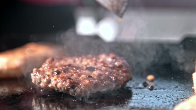 slo mo burger falling on a hot plate - hamburger stock videos and b-roll footage