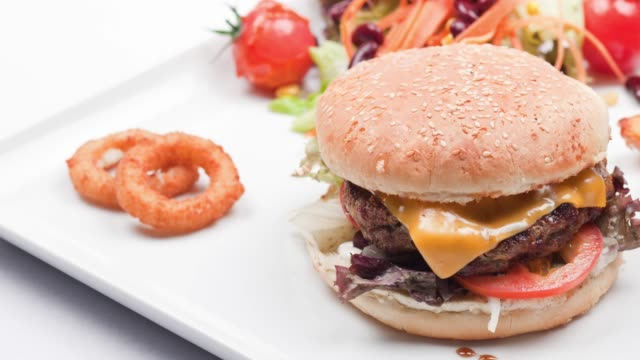 burger on a white background - cheeseburger stock videos & royalty-free footage