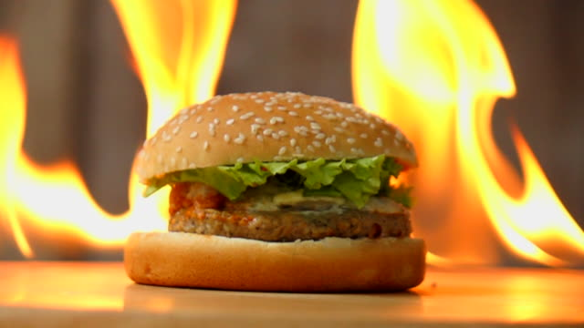 burger on fire - medium group of objects stock videos & royalty-free footage