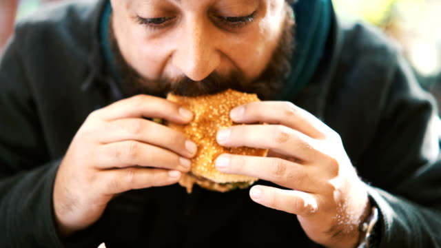 burger time. - beard stock videos & royalty-free footage