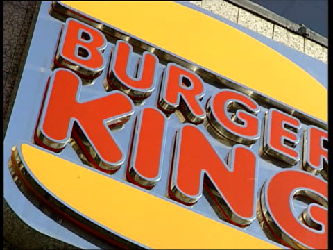 mcdonald's and burger king both announce expansion plans england london mcdonald's up man buying burger in mcdonalds restaurant hume up to counter... - data stock videos & royalty-free footage