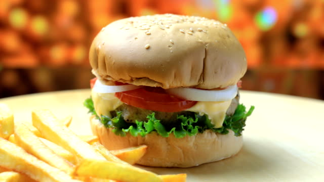 burger with french fries - cheeseburger stock videos & royalty-free footage