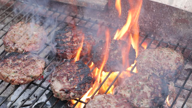 burgers on the grill - flammable stock videos & royalty-free footage