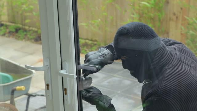 burglar breaking open the door - burglar stock videos & royalty-free footage
