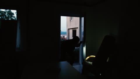 burglar in action 4k - stealing crime stock videos & royalty-free footage