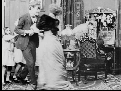 1909 b/w ws burglars (owen moore, anthony o'sullivan, herbert prior) attacking mother (marion leonard) as daughters (mary pickford, gladys egan and adele degarde) watch, then policemen and father (david miles) enter / fort lee, new jersey, usa - 1900 1909 stock-videos und b-roll-filmmaterial